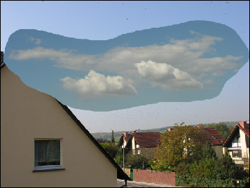 Paste the clouds into the sky