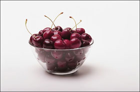 A vase with cherries