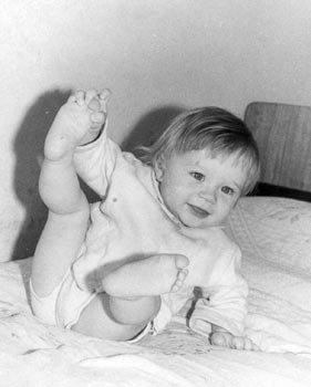 a black and white photo of a child