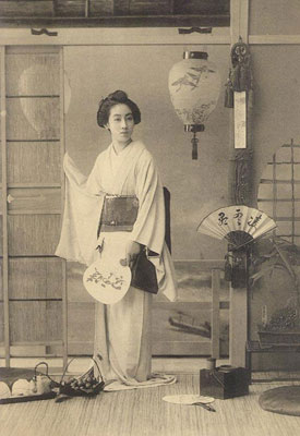 an old Japanese postcard with a Geisha
