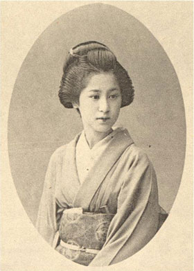 Old black and white portrait of a geisha